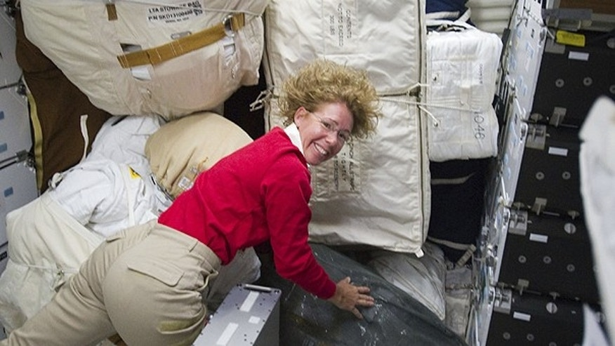 July 10: In this photo provided by NASA, NASA astronaut Sandy Magnus, STS-135 mission specialist, is pictured with only a small portion of supplies and equipment on the middeck of the space shuttle Atlantis during the very busy third day in space as the four astronauts prepare to join a six-person crew aboard the International Space Station.
