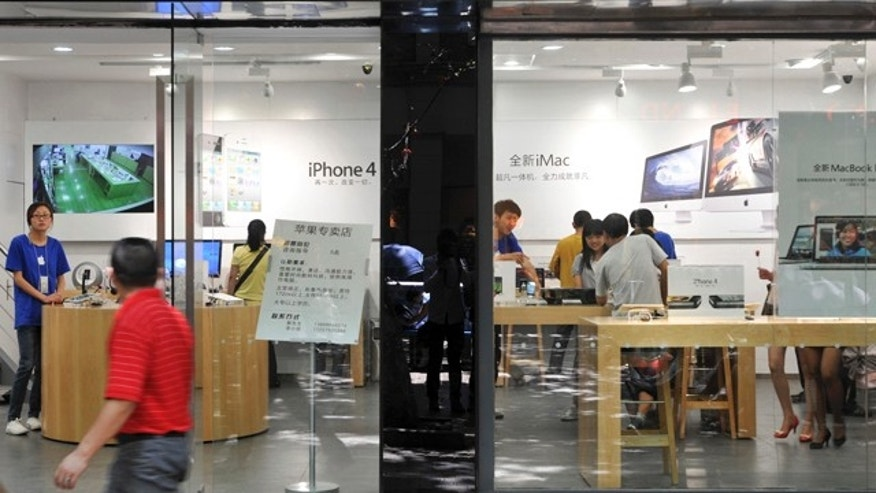 July 21, 2011: A man walks past windows of a shop masquerading as a bona fide Apple store in downtown Kunming, in southwest China's Yunnan province.