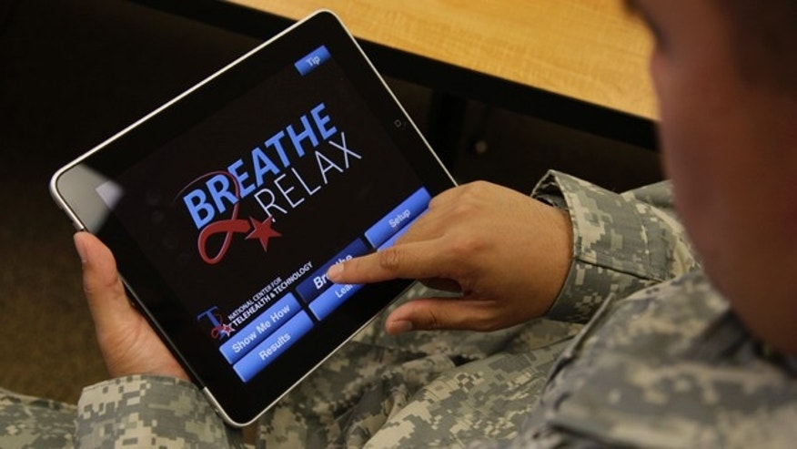 Sgt. Mark Miranda demonstrates the use of a new app that  is designed to help calm symptoms of post-traumatic stress and traumatic brain injury.