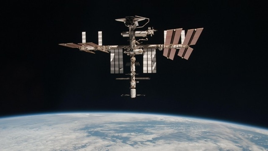The International Space Station and the docked space shuttle Endeavour, flying at an altitude of approximately 220 miles, seen from the Soyuz TMA-20 following its undocking on May 23, 2011 (USA time). It is the first-ever image of a space shuttle docked to the International Space Station.