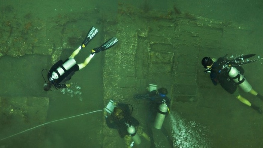 A team of U.S. archaeologists study the wreckage of a ship they believe to be part of pirate captain Henry Morgan's lost vessel. The dive team discovered approximately 52x22 feet of the starboard side of a 17th century wooden ship hull and a series of unopened cargo boxes and chests encrusted in coral.