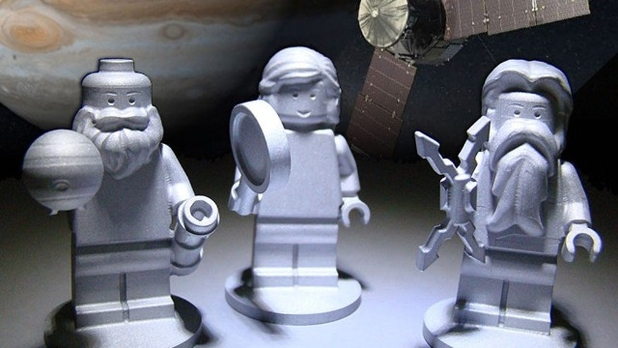 Three LEGO figurines representing the Roman god Jupiter (right), his wife Juno (middle) and Galileo Galilei (left) as shown here will fly to Jupiter on NASAs Juno spacecraft.