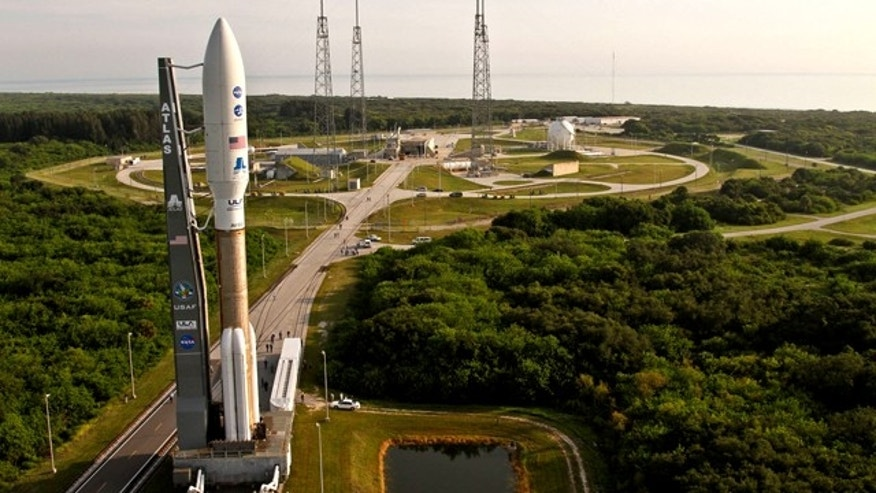 A United Launch Alliance Atlas V rocket is rolled to the pad at Space Launch Complex 41 at Cape Canaveral, preparation for the launch of a NASA mission to Jupiter.