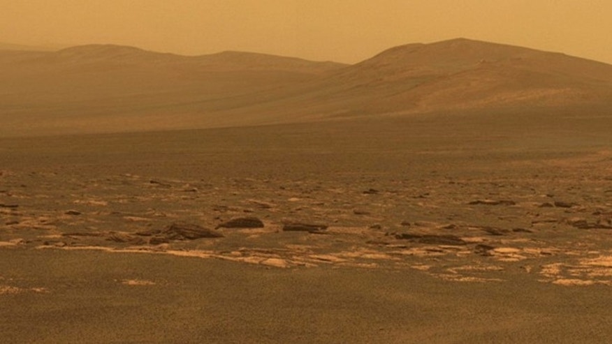 A portion of the west rim of Endeavour crater sweeps southward in this color view from NASA's Mars Exploration Rover Opportunity. This crater -- with a diameter of about 14 miles (22 kilometers) -- is more than 25 times wider than any that Opportunity has previously approached during the rover's 90 months on Mars.