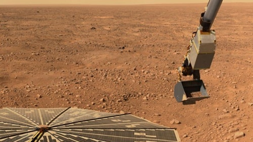 "This image shows NASA's Phoenix Mars Lander's solar panel and the lander's Robotic Arm with a sample in the scoop on June 10, 2008. The image was taken just before the sample was delivered to the Optical Microscope. This view is a part of the ""mission success"" panorama that will show the whole landing site in color."