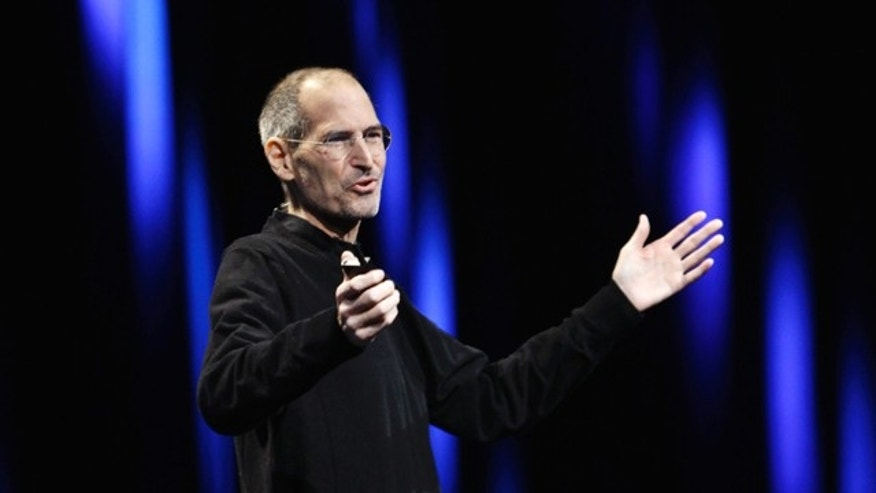 June 6: Apple CEO Steve Jobs gestures during a keynote address to the Apple Worldwide Developers Conference in San Francisco.