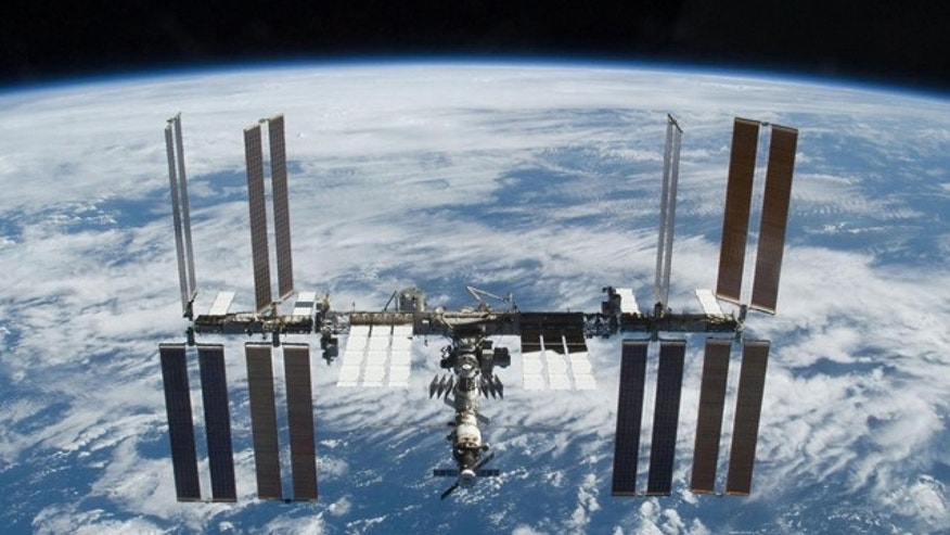 The International Space Station is photographed soon after the space shuttle Atlantis and the station began their post-undocking separation in 2009.