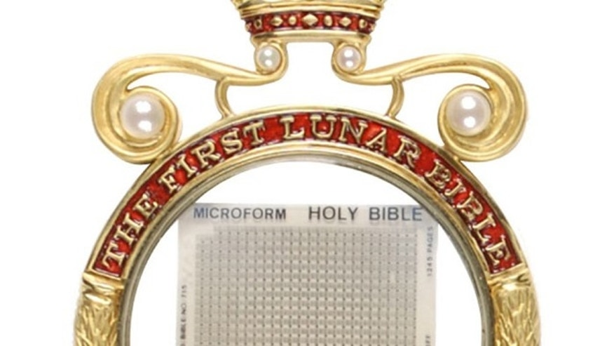 A close-up view of the first bible to land on the moon -- printed in tiny format on microfilm and on sale shortly in an auction of rare space memorabilia.