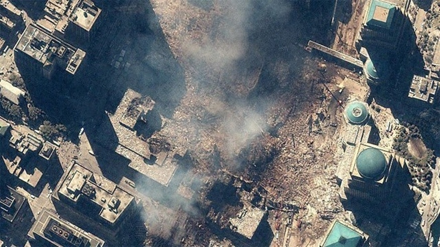 Space Imaging's IKONOS satellite collected this image of Manhattan, New York at 11:54 a.m. EDT on Sept. 15, 200. The image shows the remains of the 1,350-foot towers of the World Trade Center, and the debris and dust that settled throughout the area. Also visible are many emergency and rescue vehicles in the streets. IKONOS orbits 423 miles above the Earth's surface at a speed of 17,500 miles per hour.