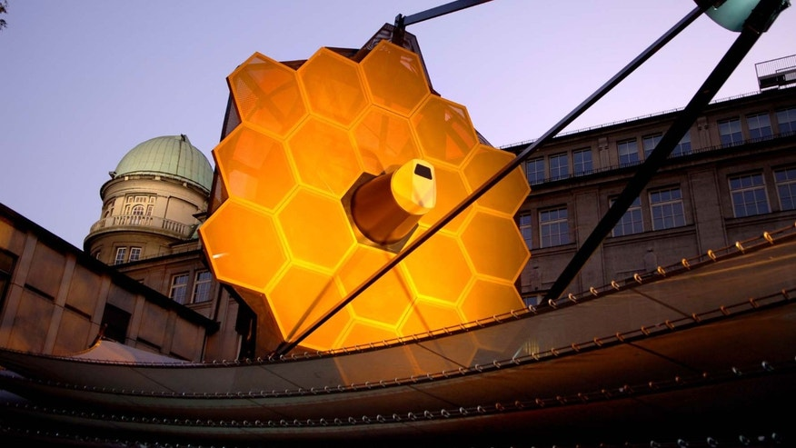 A full-scale model of the James Webb Space Telescope built by the prime contractor, Northrop Grumman, provides a better understanding of the size, scale and complexity of this satellite. The model is constructed mainly of aluminum and steel, weighs 12,000 lb., and is approximately 80 feet long, 40 feet wide and 40 feet tall. The model requires 2 trucks to ship and assembly takes a crew of 12 approximately four days.