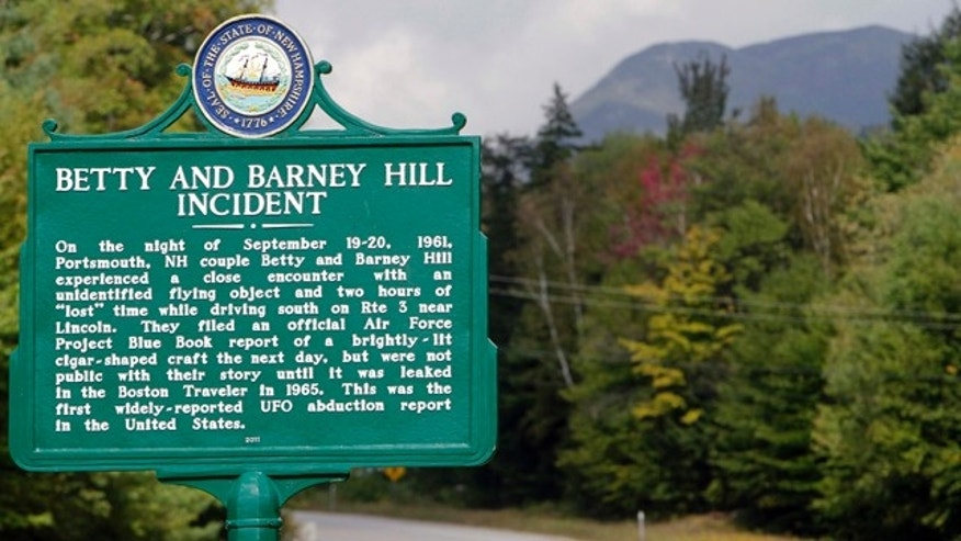 Sept. 14, 2011: A car passes through Franconia Notch where a state marker commemorates the fiftieth anniversary of a UFO sighting. In 1961, Betty and Barney Hill recalled seeing a large, flying disc-shaped object, and eventually said through hypnosis that they were abducted by extraterrestrials.