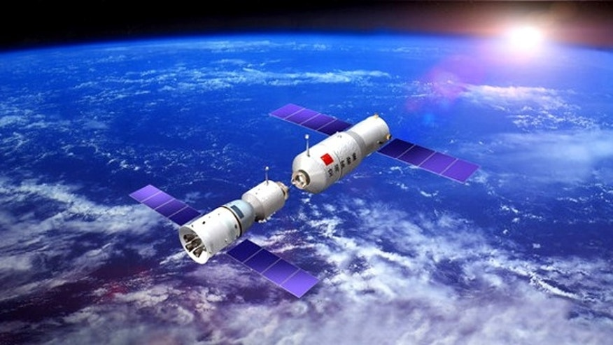 An artist's conception of China's first space station, Tiangong 1, orbiting in space.