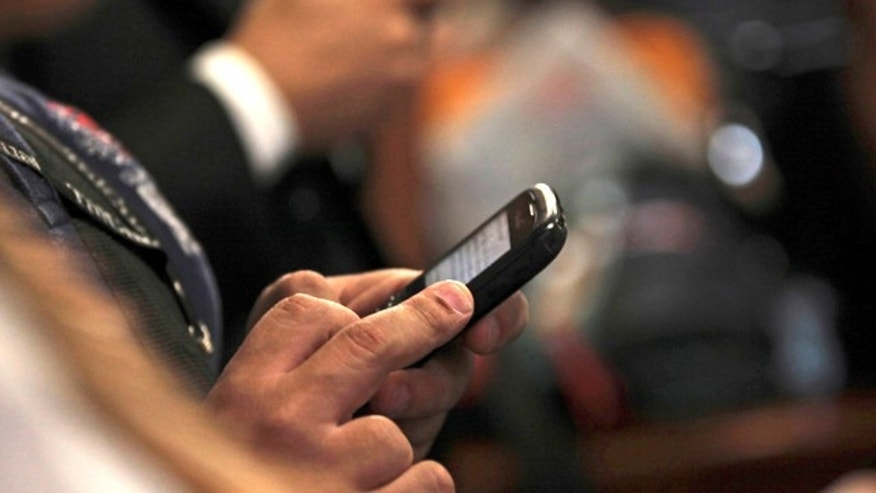 Sept. 14, 2011: A journalist tweets using his mobile phone during a news conference in Caracas, Venezuela. Bad idea. Venezuela's political battle is playing out in a new way on Twitter, where the accounts of at least nine critics of President Hugo Chavez have been mysteriously taken over by hackers who post pro-government messages along with insults and threats.