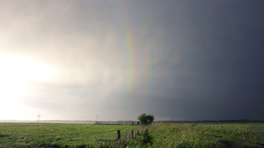 The first picture ever of a quadruple rainbow shows the third-order (left) and fourth-order rainbows (right) -- the first two aren't included in the image.