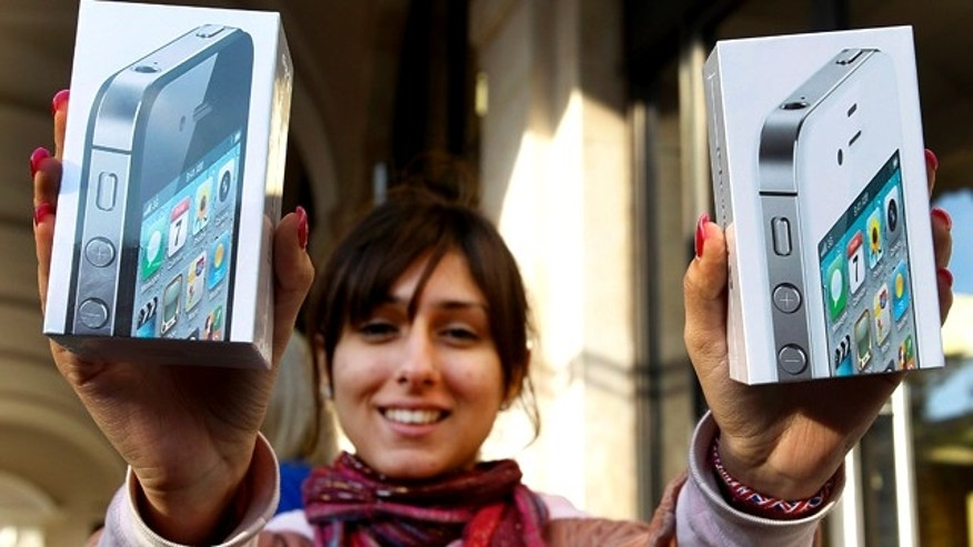 Oct. 14, 2011: Fehmeeda Bakhshi from Reading, England, holds up her purchase of two iPhone 4S smartphones outside the Apple Store  in Covent Garden.