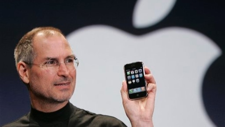 Apple co-founder Steve Jobs shows off an early iteration of the iPhone in 2007.
