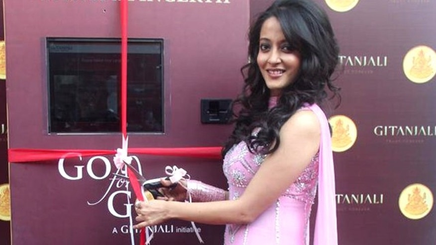 Oct. 22, 2011: An ATM that dispenses gold medallions, coins, diamonds, jewellery and more was opened for business by Bollywood star Raima Sen and Sanjeev Agarwal, CEO of manufacturer Gitanjali Export Corp.
