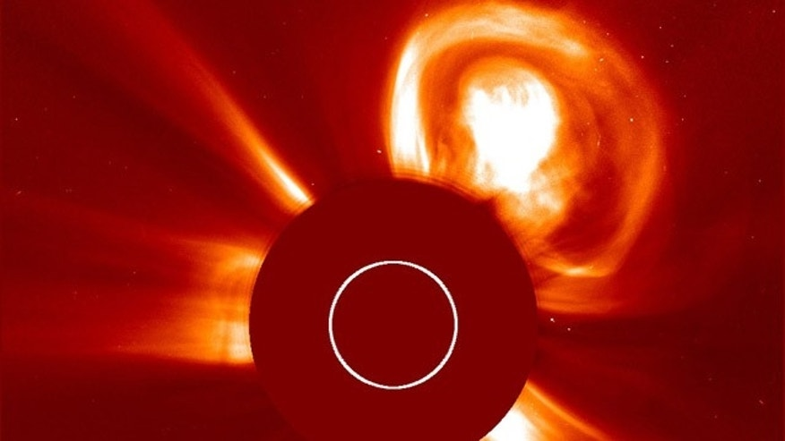 A gigantic solar eruption shoots out from the sun -- straight towards the Red Planet.