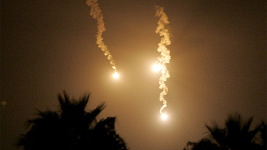 Image: Flares in the sky -- like the military flares seen here during the Lebanon-Israel conflict in 2006 -- can be misidentified as UFOs.