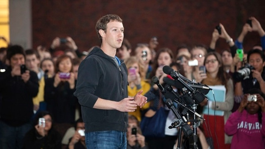 Nov. 7, 2011: Facebook creator Mark Zuckerberg speaks to students outside Lamont Library on the campus of Harvard University, in Cambridge, Mass.