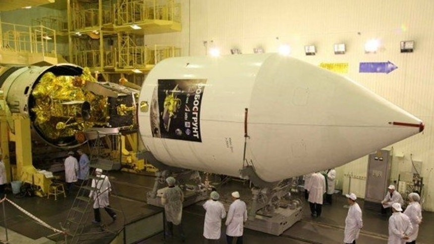 Phobos-Grunt and Yinghuo-1 spacecraft being encapsulated inside the nose cone for November 9 launch (Nov. 8 EST) to Mars and its tiny moon Phobos.