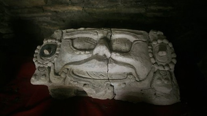 A ceramic head found in a newly discovered tomb sits on display at the Mayan Tonina archeological site near Ocosingo village in Mexico's Chiapas state.
