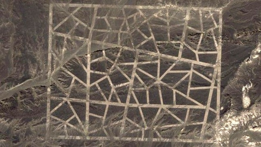Conspiracy theorists are having a field day with new images from Google Earth showing strange patterns covering miles of Chinese desert.