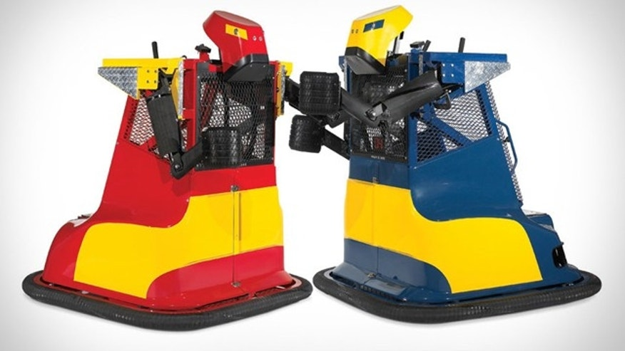 Rock 'Em Sock 'Em Robots has nothing on these. Arriving in a package weighing 850 lbs. (!), these Robot Boxing Machines ($17,000) take recreational robot warfare to a new level.