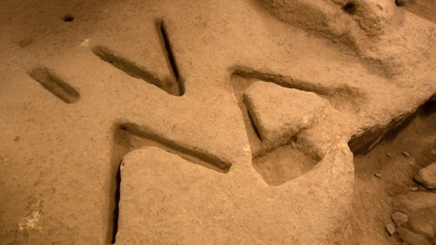 Dec. 1, 2011: Marks carved in the bedrock over 2,800 years ago, seen in an archeological excavation in the city of David near Jerusalem's Old City, have archaeologists stumped.