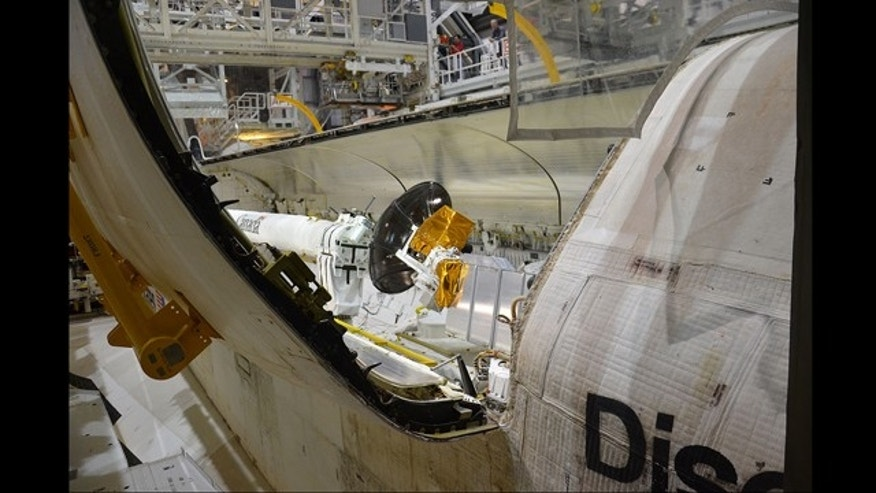Dec. 16, 2011: Space shuttle Discovery's twin, 60-foot payload bay doors were closed for a final time at NASA's Kennedy Space Center in Florida.