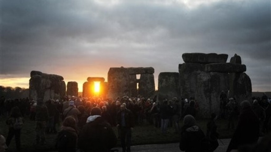 Dec. 22, 2011: People watch the sunrise at the northern Winter Solstice celebration at Stonehenge in Wiltshire. The omens are good that 2012 will be an excellent year, a druid said, after the sun shone on Stonehenge during a dawn ceremony to mark the winter solstice.