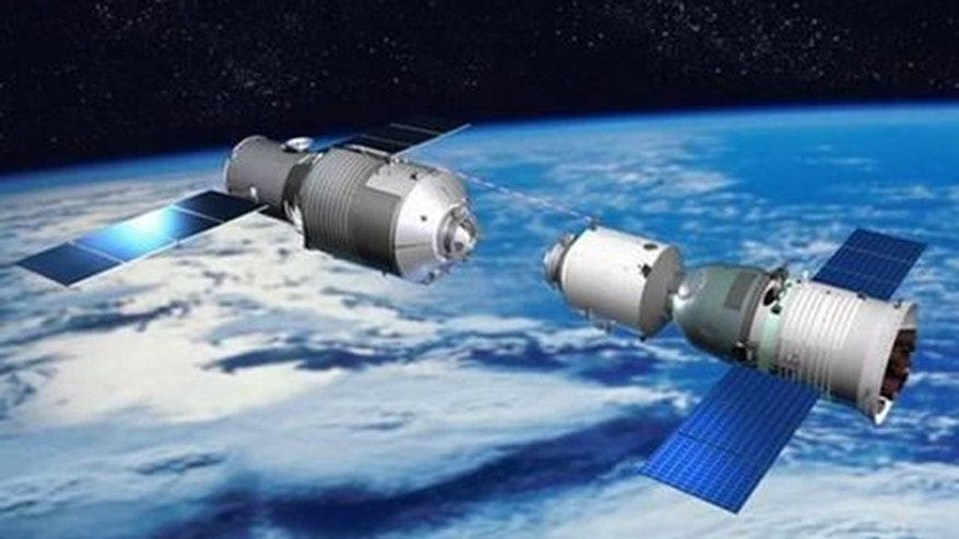 This illustration depicts a Chinese Shenzhou vehicle approaching the Tiangong 1 space lab during orbital rendezvous and docking tests, a precursor for space station construction.