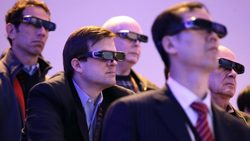 Jan. 6, 2011: Attendees watch a 3D HDTV presentation by Panasonic at the 2011 Consumer Electronics Show, in Las Vegas.