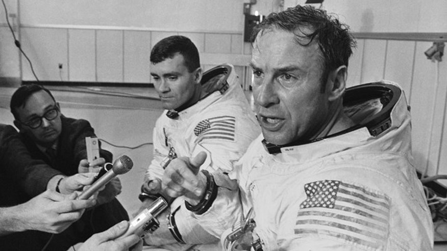 In this April 15, 1970, file photo, Apollo 13 commander James A. Lovell Jr. speaks during a news conference in Cape Kennedy, Fla. before the spacecraft launched on its ill-fated journey to the moon. At center is astronaut Fred Haise.