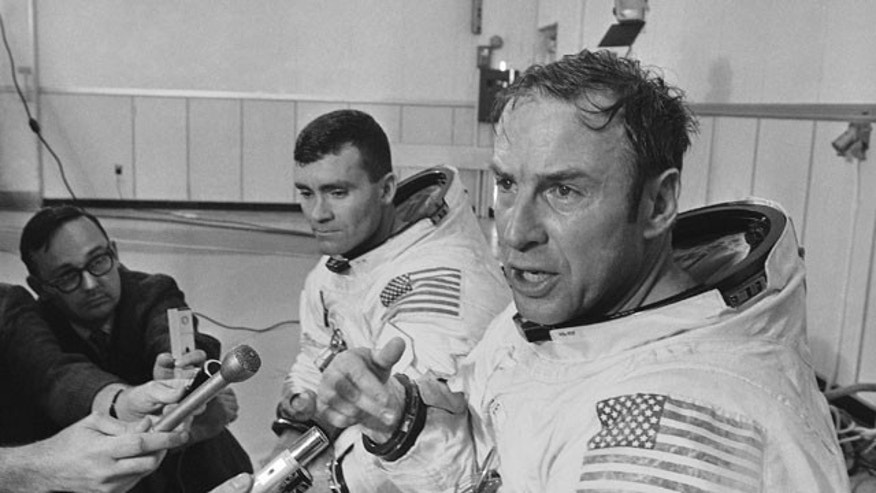 In this April 11, 1970 file photo, Apollo 13 commander James A. Lovell Jr., foreground, speaks during a news conference in Cape Kennedy, Fla. before the spacecraft launched on its ill-fated journey to the moon.