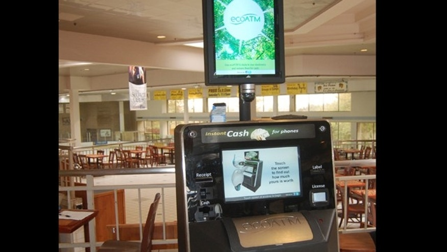 This undated photograph provided by ecoATM, shows the EcoATM, which is a cupboard-sized machine with a big touch screen and a big metal mouth where you can place your old phone or MP3 player. Its analysis complete, it gives you a quote on the spot, based on what a network of hundreds of electronics-recycling companies are willing to pay for it. If you accept, it spits out cash.