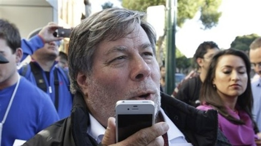Apple co-founder Steve Wozniak tests out Siri on the iPhone 4S.
