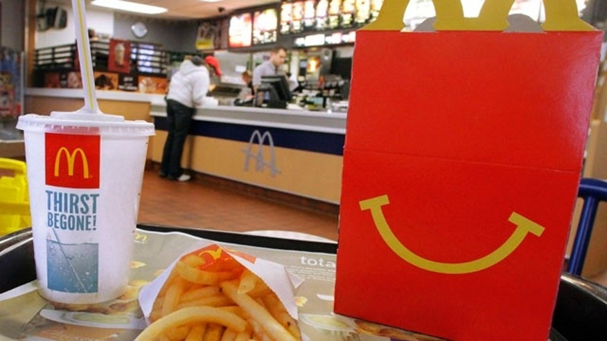 In this Jan. 20, 2012 photo, the McDonald's logo and a Happy Meal box with french fries and a drink are posed at McDonald's, in Springfield, Ill.  McDonald's Corp. saw net income jump by 11 percent in the fourth quarter, as the fast-food giant continued to attract budget-conscious customers with low prices.  (AP Photo/Seth Perlman)