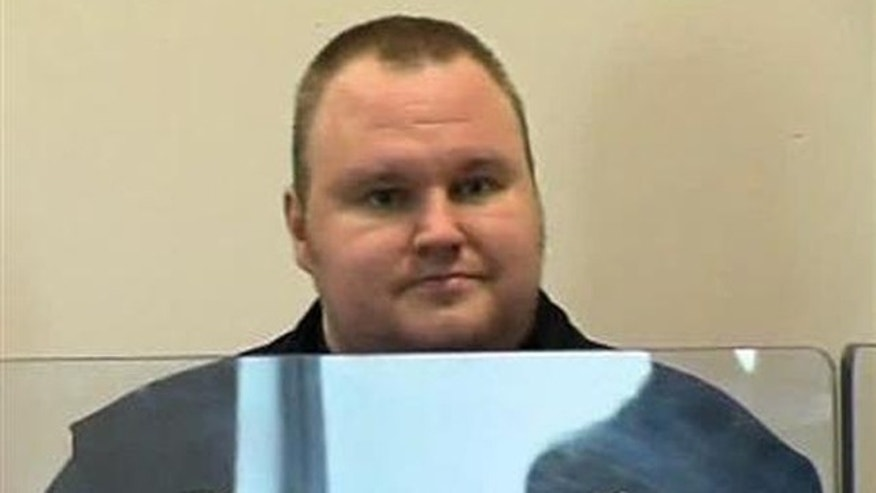Jan. 20, 2012: Megaupload founder Kim Dotcom appears in Auckland's North Shore District Court after his arrest in this still image taken from a  video.