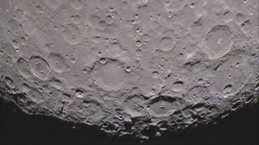 Caption:One of NASA's twin Grail spacecraft has returned its first unique picture of the far side of the moon, an image that shows shadowed craters at the moon's south pole.