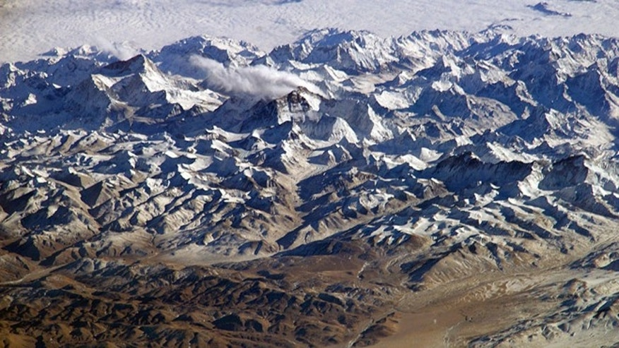 Astronauts on board the International Space Station recently took advantage of their unique vantage point to photograph the Himalayas, looking south from over the Tibetan Plateau. Mt. Everest (29,035 feet) is at right.