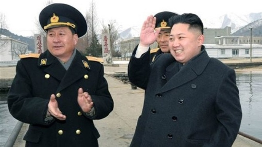 Feb. 7, 2012: North Korean leader Kim Jong Un, right, salutes when he visited Unit 158 of the navy of the North Korean People's Army.