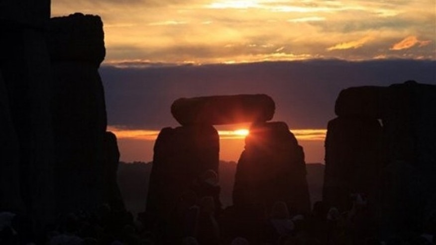 June 21, 2010: The sun rises behind the Stonehenge monument in England during the summer solstice, shortly after 4:52 am, early Monday.