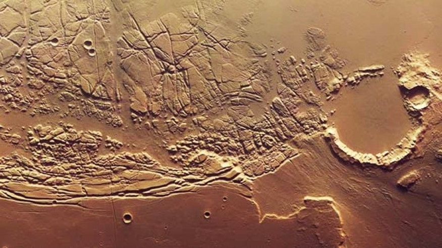 Mars Express flew over the boundary between Kasei Valles and Sacra Fossae and imaged the region, acquiring spectacular views of the chaotic terrain in the area. The images are centred at 12°N/ 285°E and have a ground resolution of about 69 feet (21 m) per pixel.