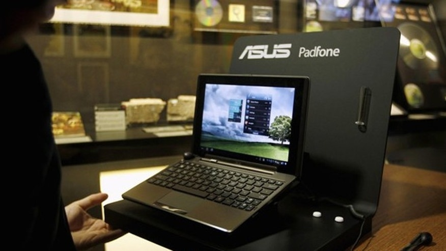 Feb. 27, 2012: Asus' new Padfone is seen on display after a news conference during the Mobile World Congress in Barcelona. The GSMA Mobile World Congress, representing the interests of the worldwide mobile communications industry, will take place from February 27 to March 1 in Barcelona.