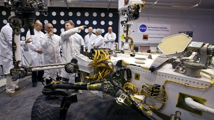 Feb. 22, 2011: NASA administrator Charles Bolden, third from left, listens to engineer Matt Robinson, during a tour of a replica of the Mars Science Laboratory rover at NASA's Jet Propulsion Laboratory in Pasadena, Calif.