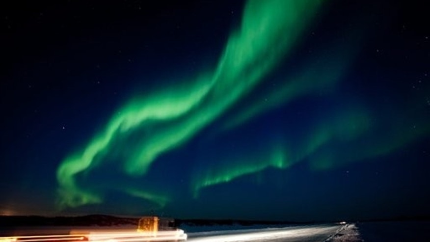 March 8: The largest solar storm in five years sent a huge wave of radiation into Earth's atmosphere creating a brilliant show of the aurora borealis near Yellowknife, North West Territories.