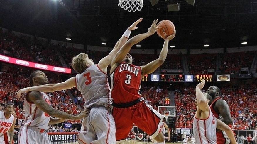 UNLV's Anthony Marshall is fouled by New Mexico's Hugh Greenwood in the second half of a semifinal NCAA college basketball game during the Mountain West Conference tournament, Friday, March 9, 2012, in Las Vegas. (AP Photo/Julie Jacobson)
