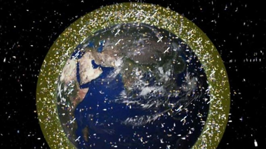 This computer illustration depicts the density of space junk around Earth in low-Earth orbit.