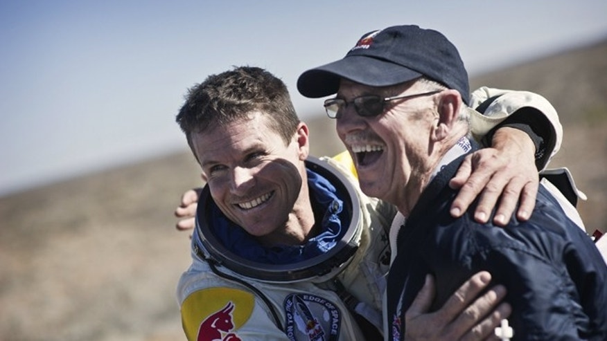 March 15 2012: Felix Baumgartner of Austria and life support engineer Mike Todd of the United States celebrate after the landing at the first manned test flight for Red Bull Stratos in Roswell, New Mexico. In this test he jumped from 71,500 ft and landed safely near Roswell.